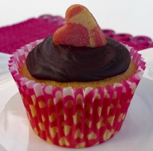 Hidden heart cupcake with chocolate frosting